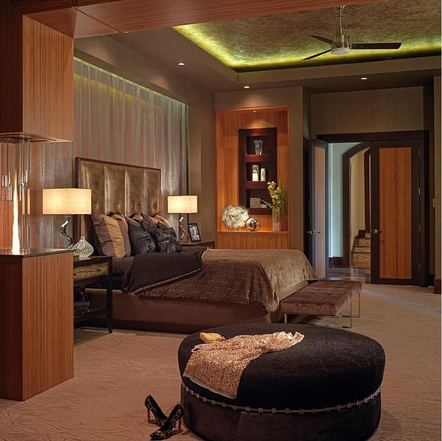 What to Know Before Remodeling Your Master Bedroom. Dark brown and coffe color palette for modern styled room with round ottoman and LED ceiling lighting