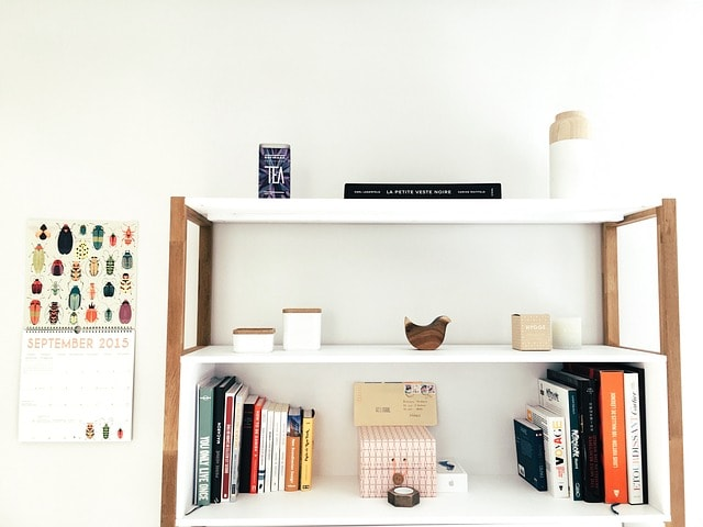 How to Tell if You're a Minimalist or a Maximalist. White minimalist interior with bookshelf