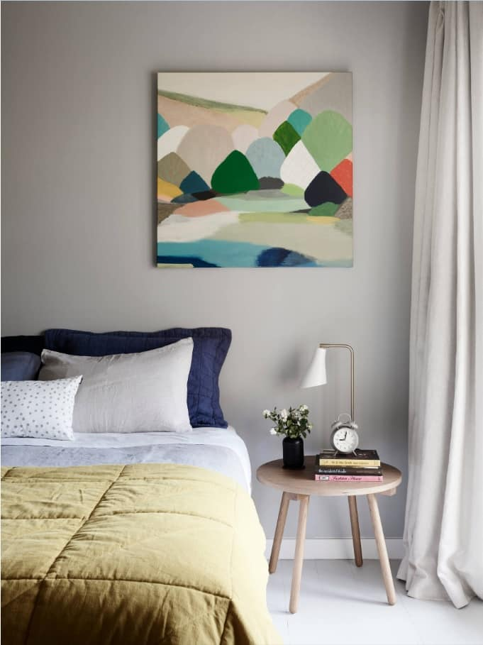 How to Create the Perfect Guest Bedroom. Cozy Scandinavian theme for the room with large impressionistic picture