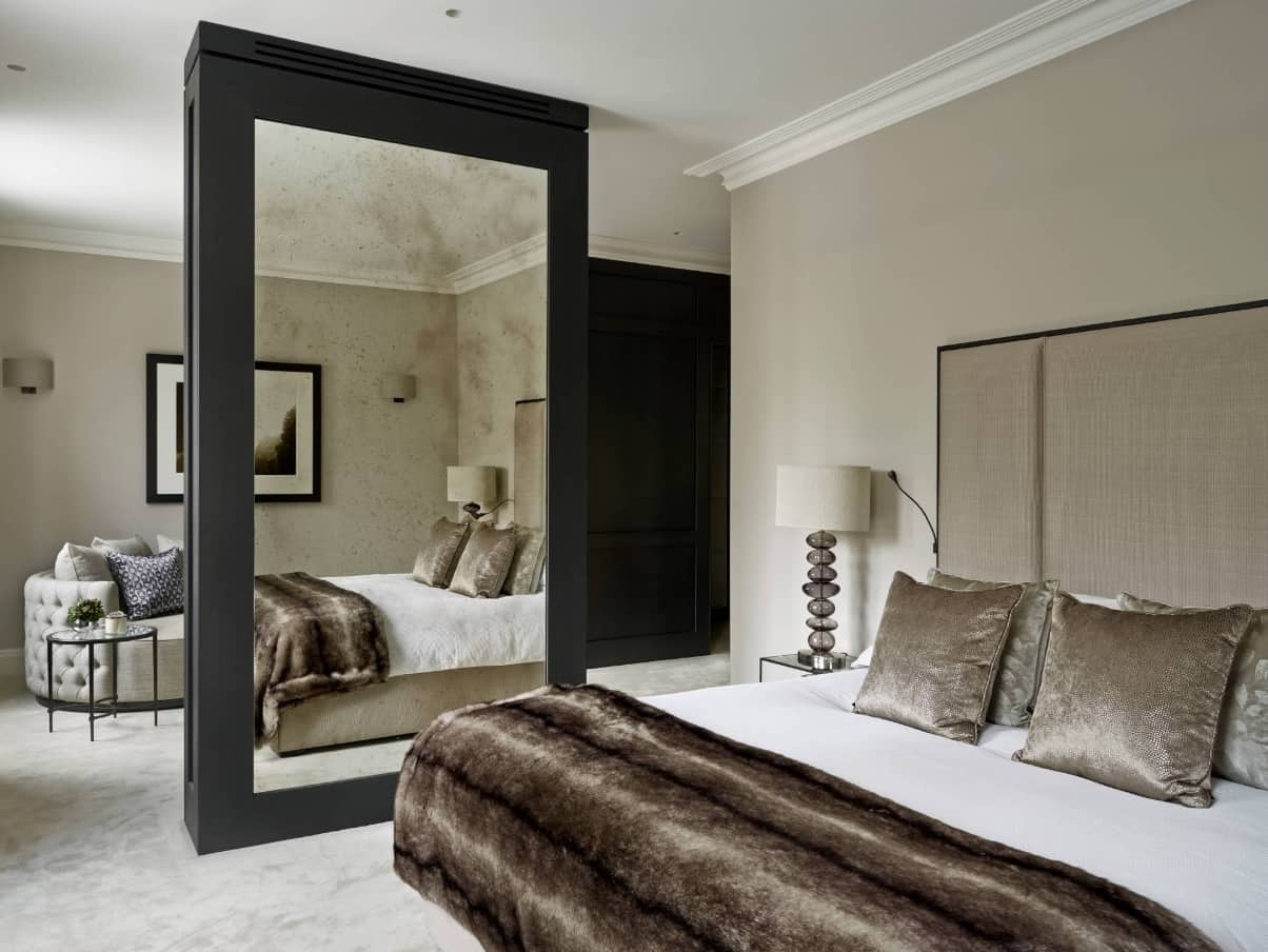 How to Create the Perfect Guest Bedroom. Great modern interior with large mirror at the black accent wall