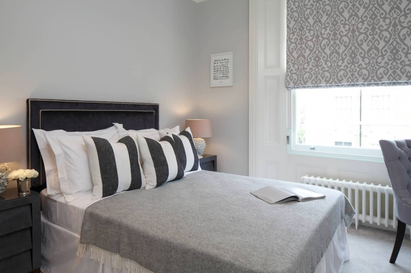 How to Create the Perfect Guest Bedroom. Contemporary simple designed room with roller blind