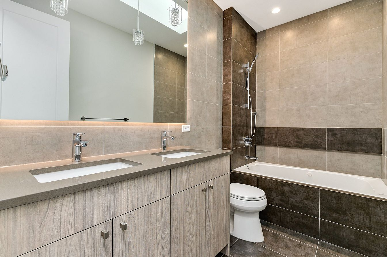 Small Modern Minimalist House in Chicago Downtown Review. Amazing second bathroom with large mirror and stone/wood combined finishing