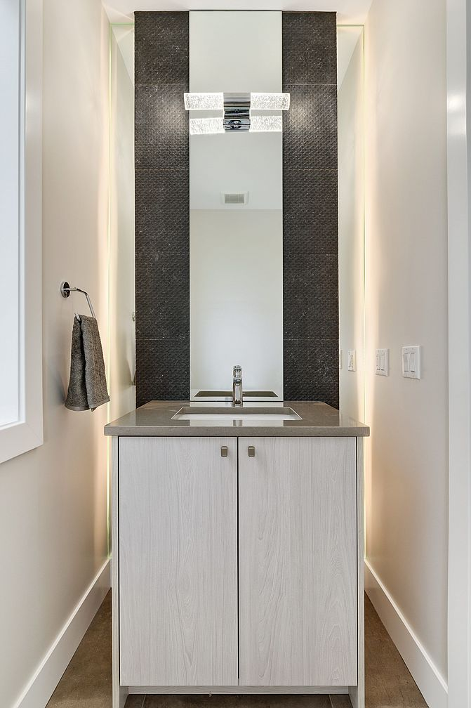 Small Modern Minimalist House in Chicago Downtown Review. Recess for vanity in white with LED backlight