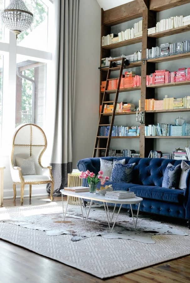 Marble Side Table for Modern Interior Design: Complement Your Home. Blue quilted sofa and open book shelf