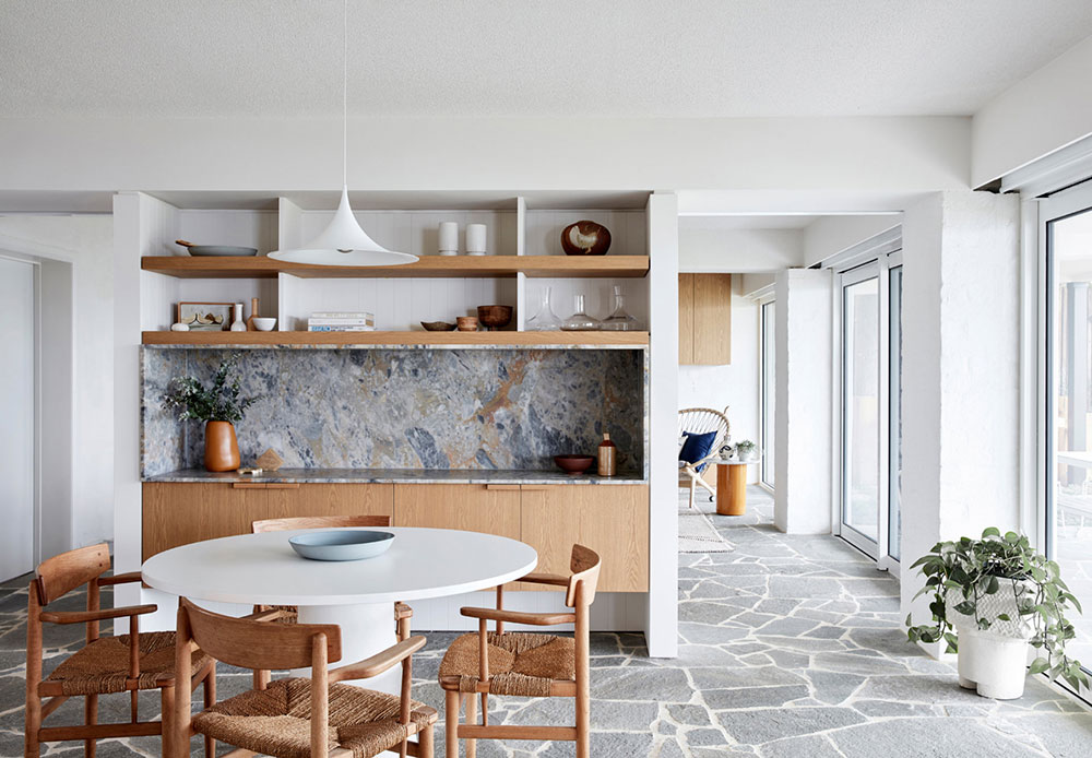 Apparent Scandinavian style in the interior of the small beach house with stone slab floor