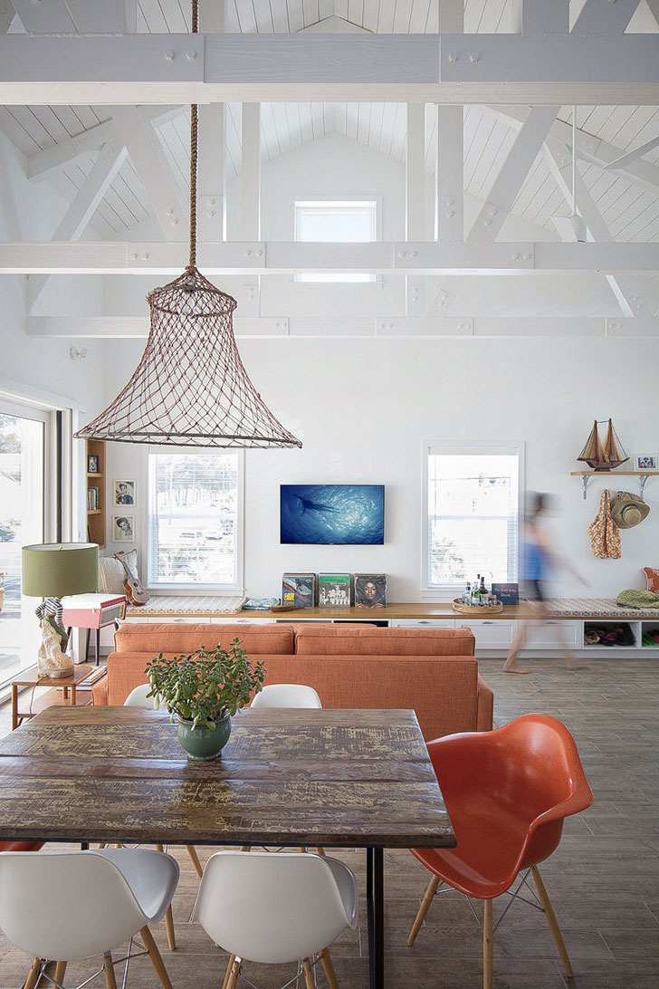 Stunning Photo Compilation of Small Beach House Designs that Inspire. Open layout space with the wooden tabel dining zone and wicker lampshade over it