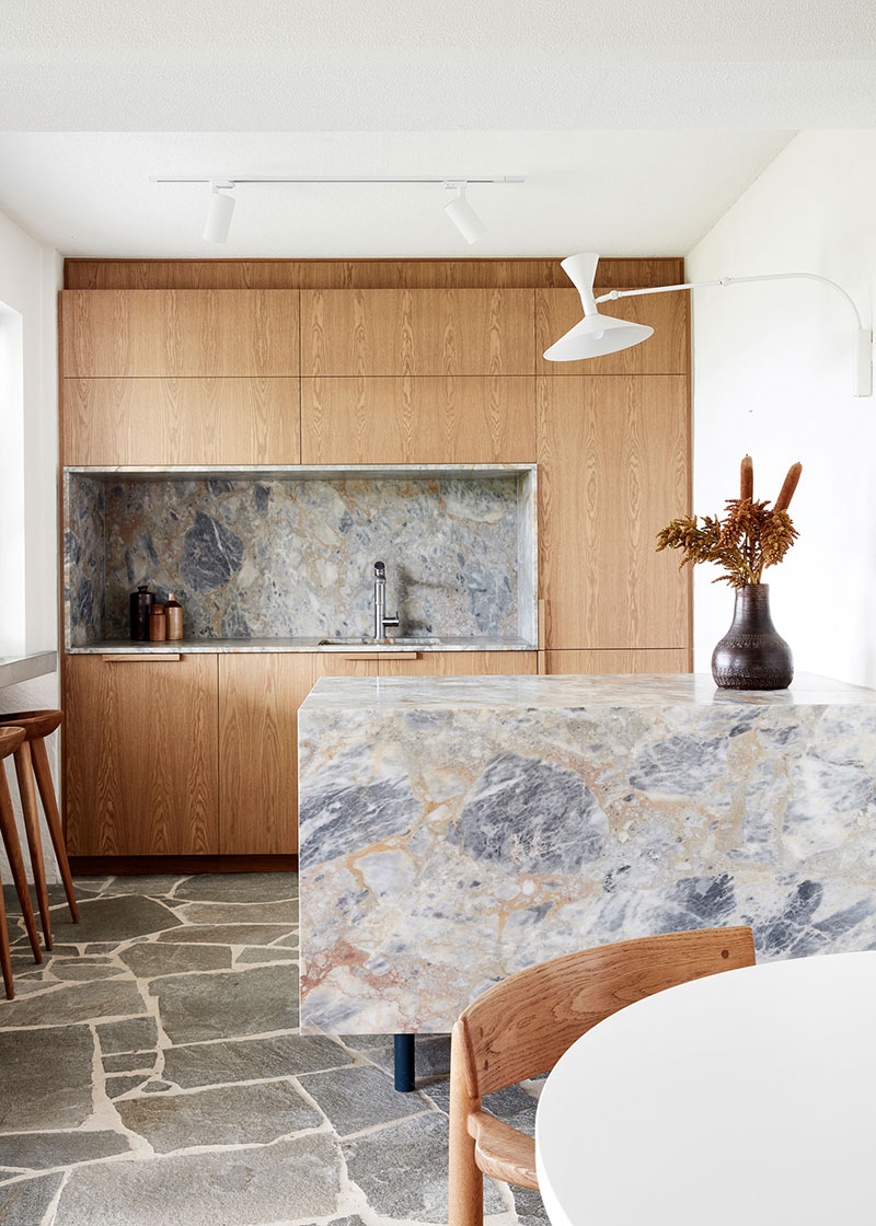 Wooden cabinet at the dining room with marble island