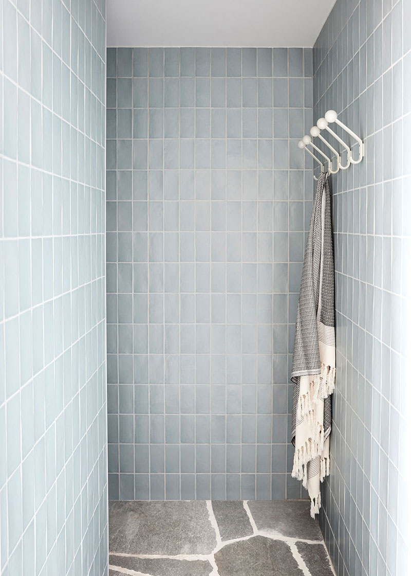 Simple designed shower zone with pale blue tile