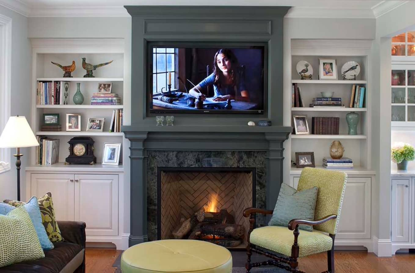 4 Helpful Space Saving Ideas for Any Home. Accentual carved frame fireplace in classic interior and the TV above it