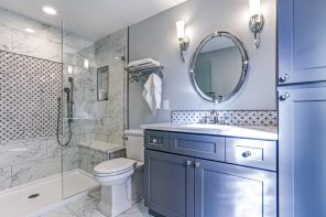 Spruce up Your Washroom: 8 DIY Shower Remodeling Ideas. Marble wall finishing in the shower zone and gray painted walls in the rest of the bathroom