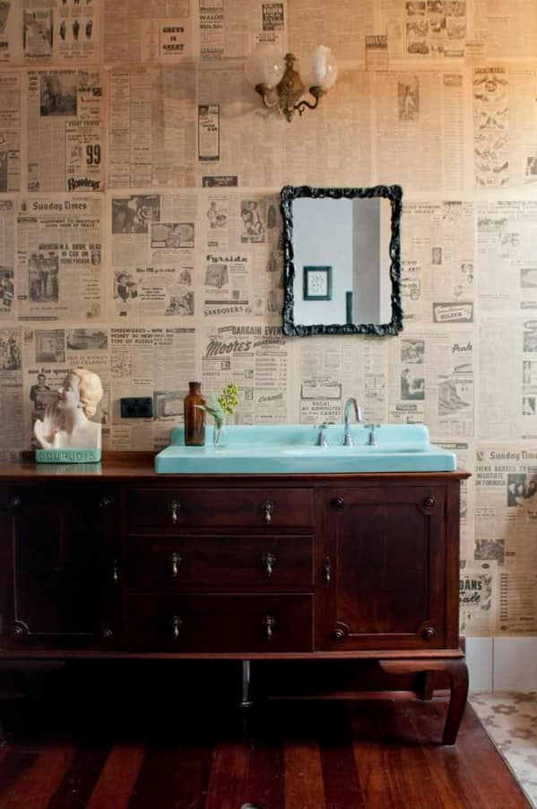 Spruce up Your Washroom: 8 DIY Shower Remodeling Ideas. dark noble wooden dresser with turquoise sink and statue