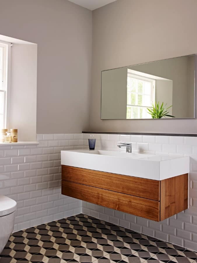 Spruce up Your Washroom: 8 DIY Shower Remodeling Ideas. Suspended vanity with wooden side and white ceramic top