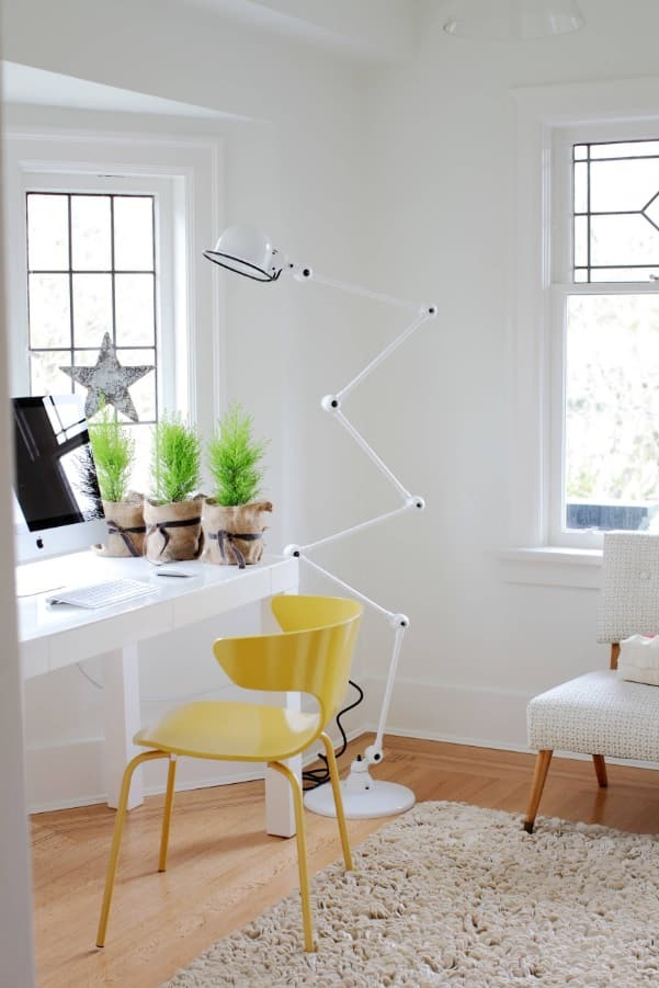 Tiny Home Interiors that Can Inspire Making Your Space more Functional. White home office design with plants on the table and yellow chair