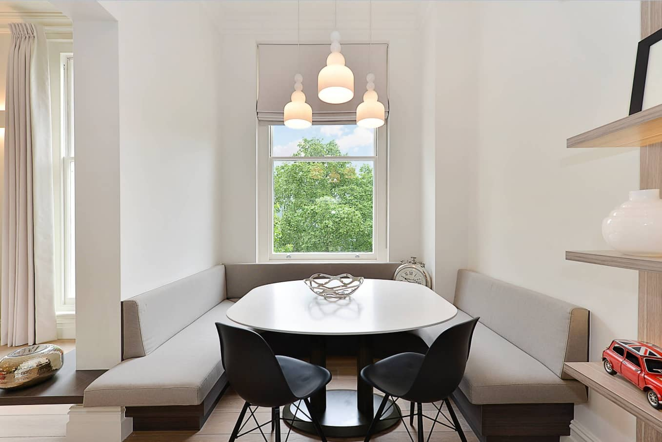 Tiny Home Interiors that Can Inspire Making Your Space more Functional. Small cozy dining room with gray sofas and black chairs