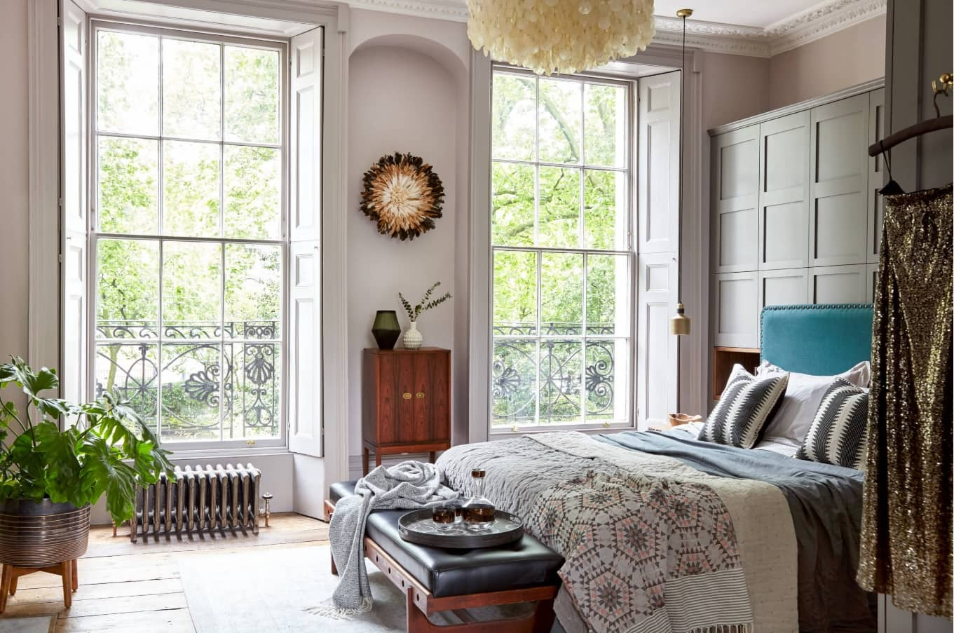 Mix of Styles for Unique Atmosphere of Transitional Master Bedroom. Large sash windows for bright though simple designed high room