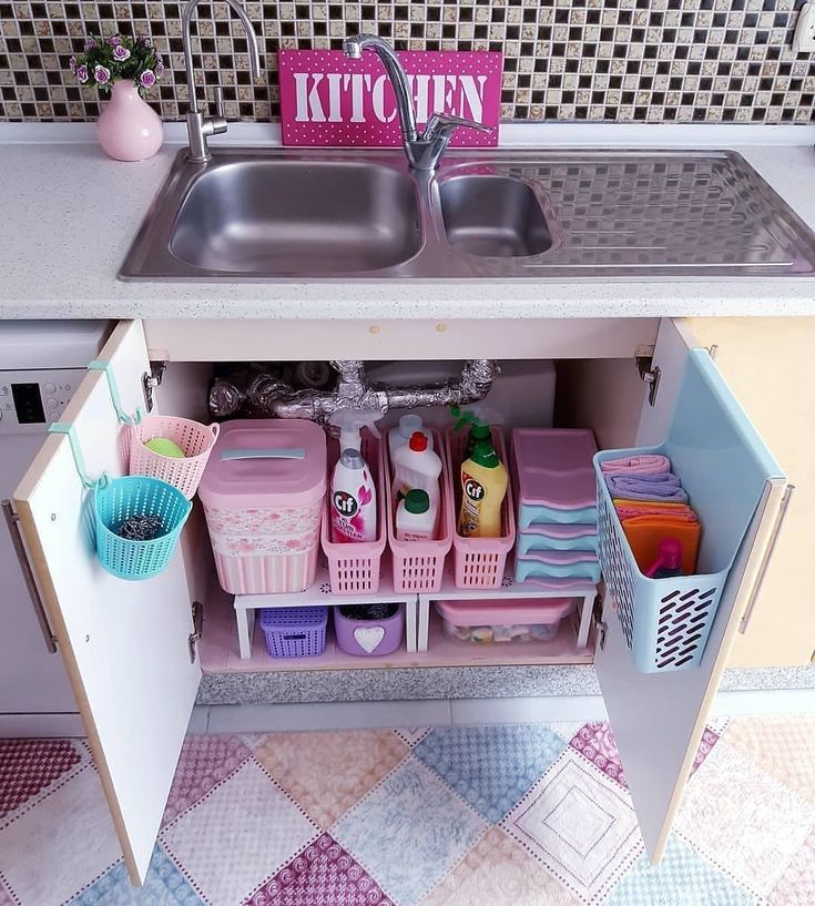 The compartment for detergents under the sink