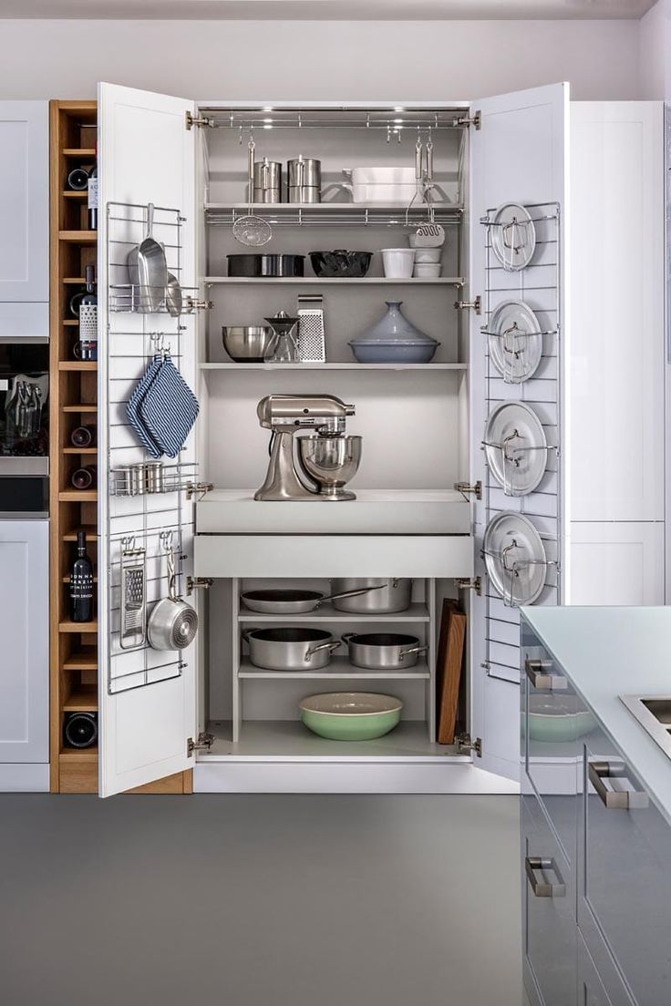 Nice and very functional cabinet for storing kitchen utensils that closes and hide everything completely