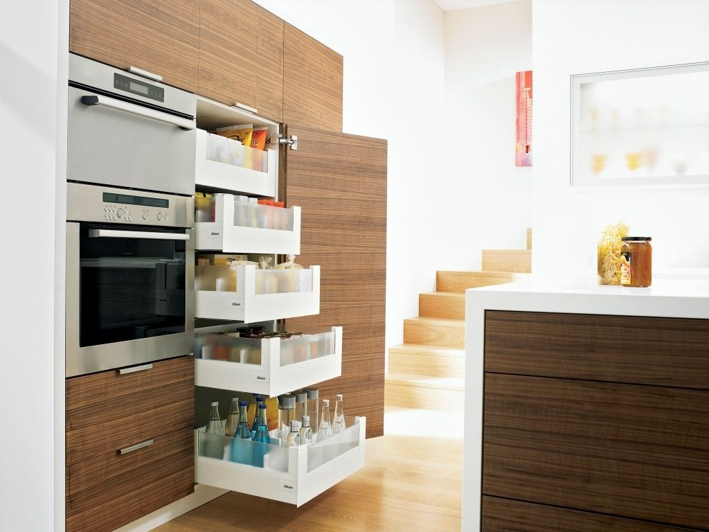Organizing Kitchen Storage Systems and Pantry for Ultimate Comfort. Great designed pantry near the microwave compartment for modern wooden facaded kitchen