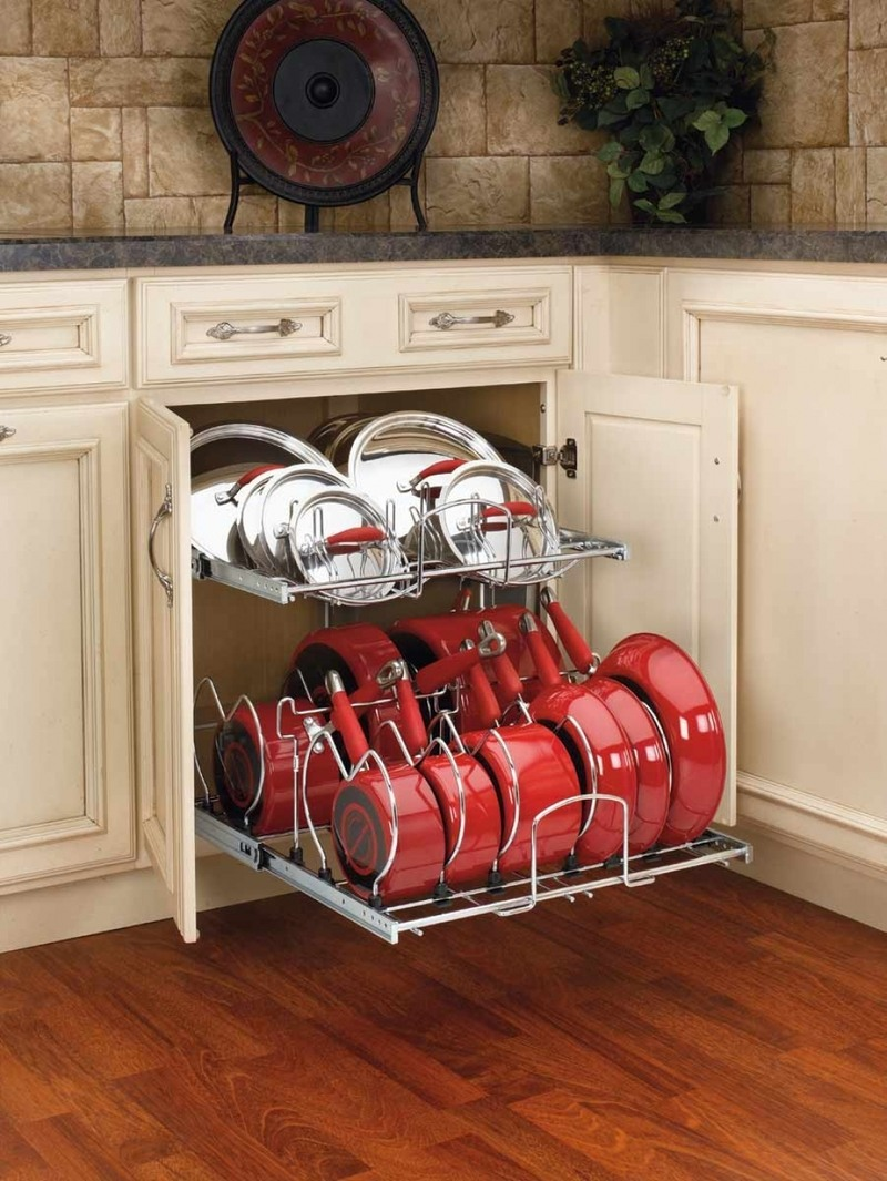 Organizing Kitchen Storage Systems and Pantry for Ultimate Comfort. Classic designed room in creamy color with large compartment for frying pans