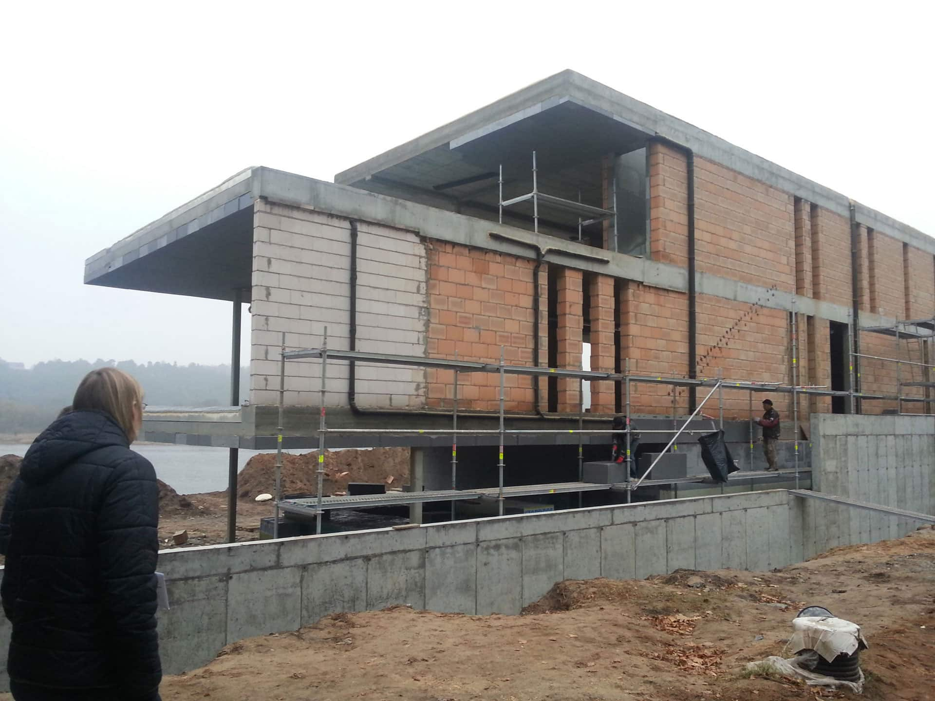 The back view of the construction the flat roof house in Luthuania