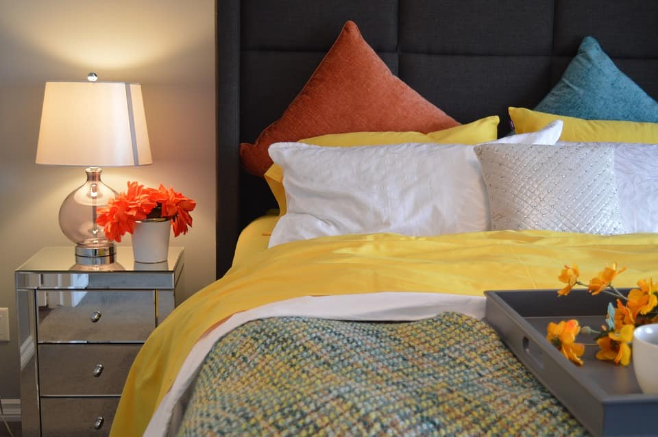 Best Tips to Design Your Bed with a Beautiful Mattress. Vibe bedding colors to decorate the bedroom with the black quilted headboard