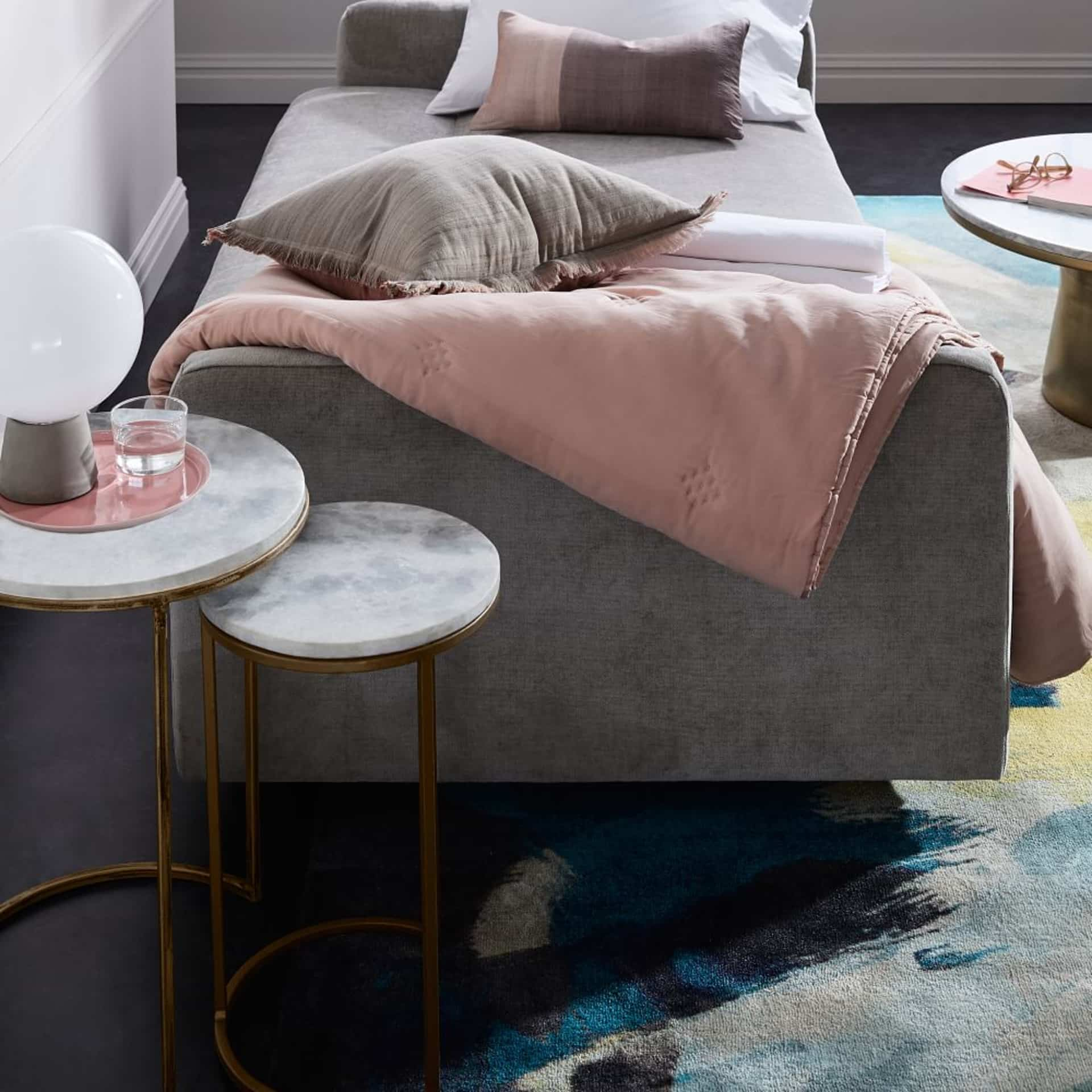 Marble Side Table for Modern Interior Design: Complement Your Home. Gray velour sofa and the marble top nesting table near
