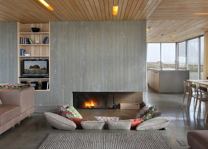 The Overview and Examples of Norwegian Interior Design. Wooden planked ceiling and accent grey wall with the fireplace