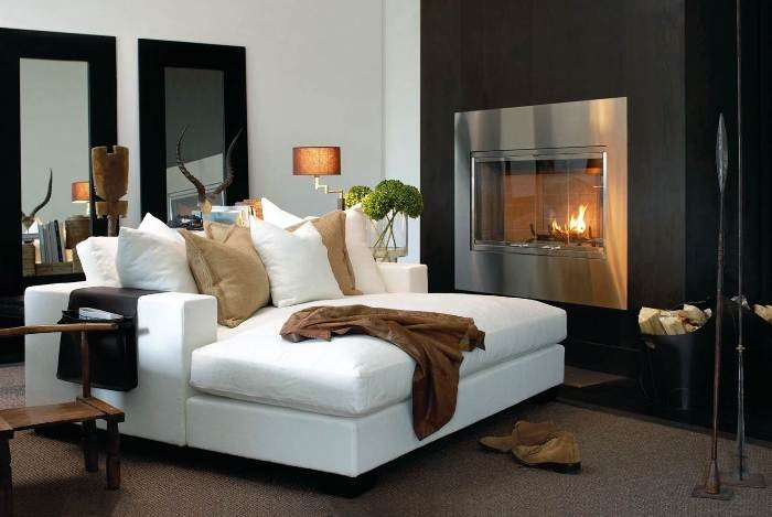 The Overview and Examples of Norwegian Interior Design. Simple designed living room with white sofa and electric steel framed fireplace