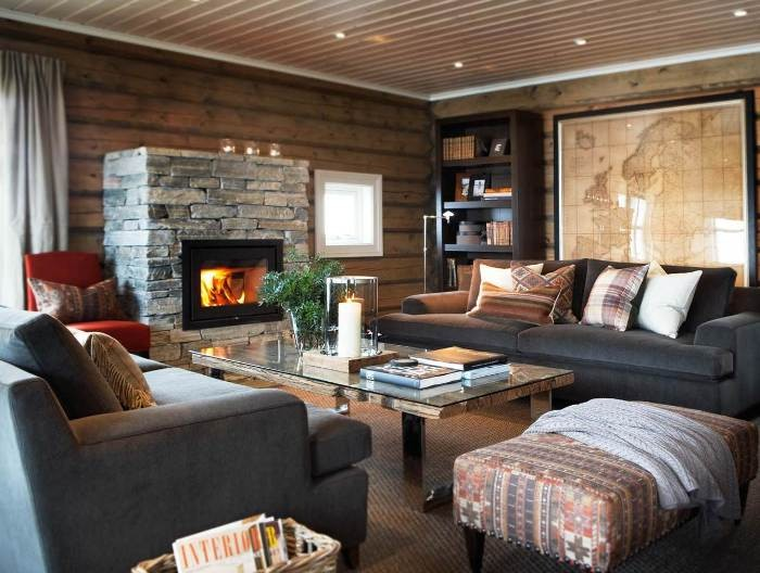 The Overview and Examples of Norwegian Interior Design. Rustic interior with wooden walls and stone trimmed fireplace