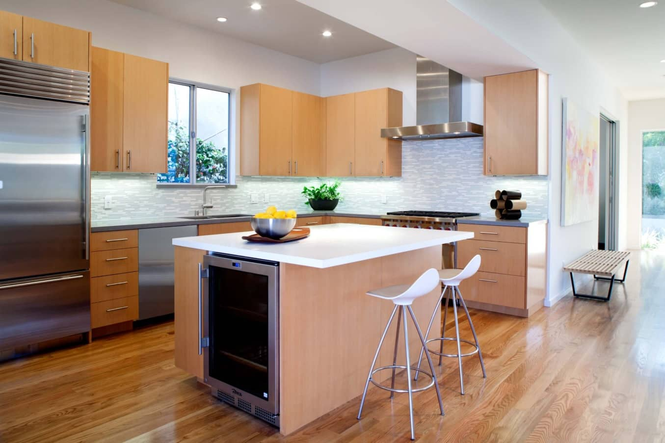 Enhance Home Interior with Stylish Appliances Without Breaking Bank. Nice contemporary designed kitchen with mild wooden tone and laminated floor
