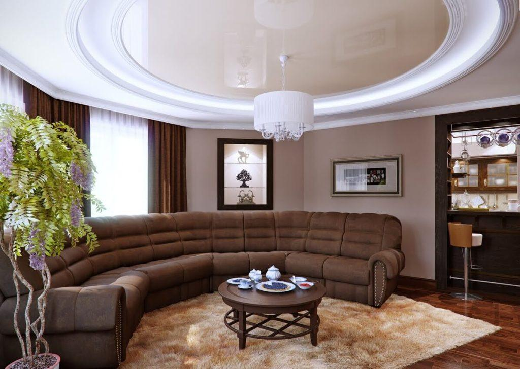 Rounded room with semi-circle living zone and brown round table