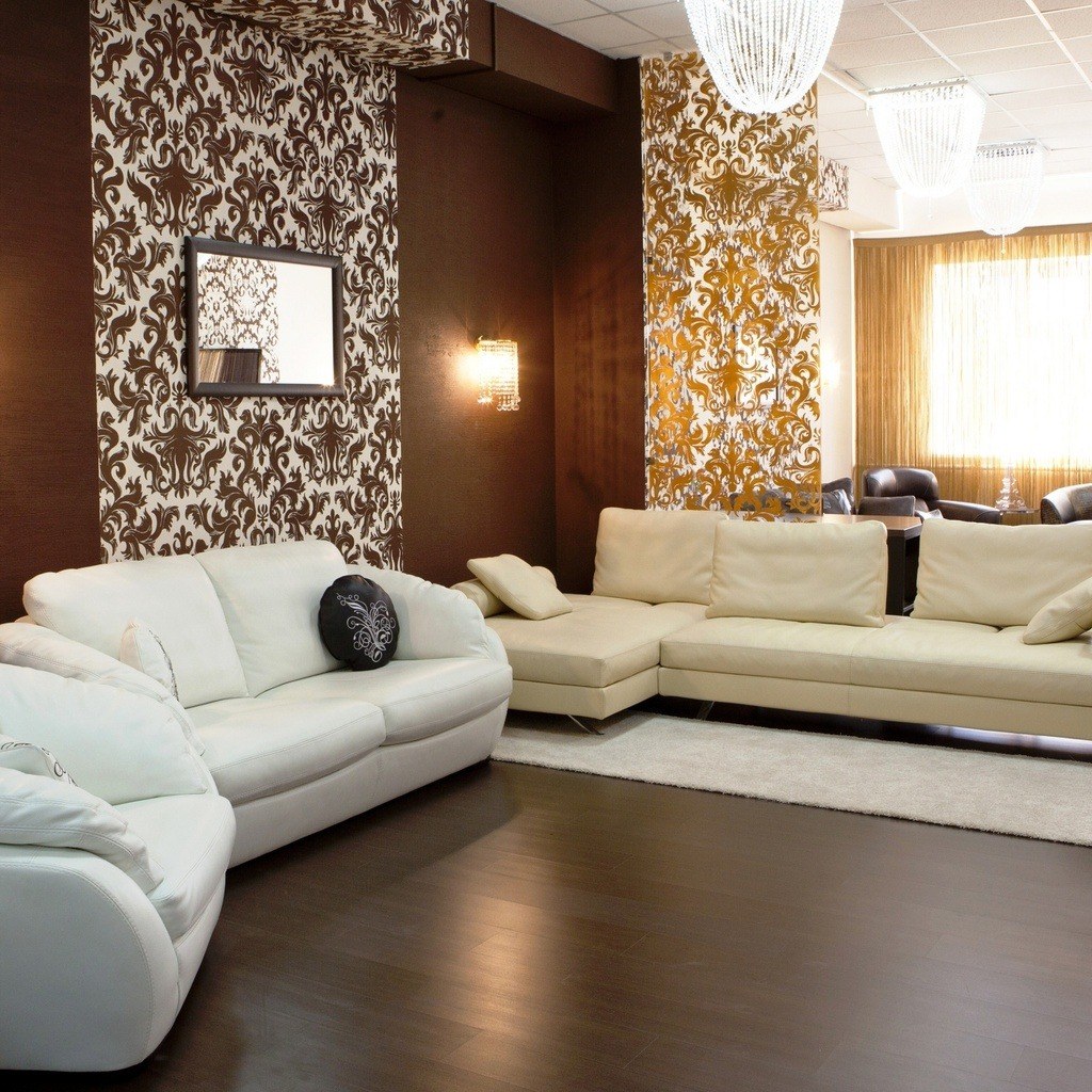 Nice brown wallpaper with white pattern and white leather upholstered furniture set