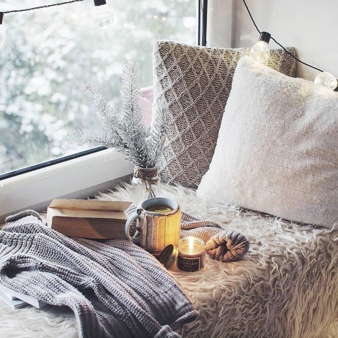 Great cozy windowsill sleeper with aroma candle and personal things