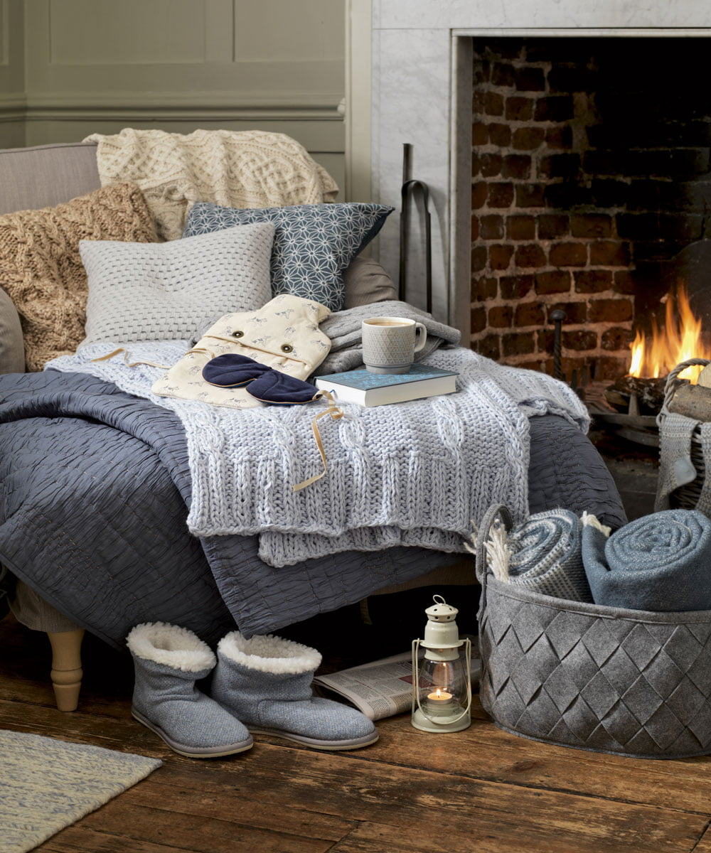 Hygge Interior Design Style and Life Philosophy: Cozy Danish Tradition. Scandinavian warm decorated bedroom with brick hearth