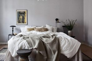 Hygge Interior Design Style and Life Philosophy: Cozy Danish Tradition. Gray wall and fluffy carpet