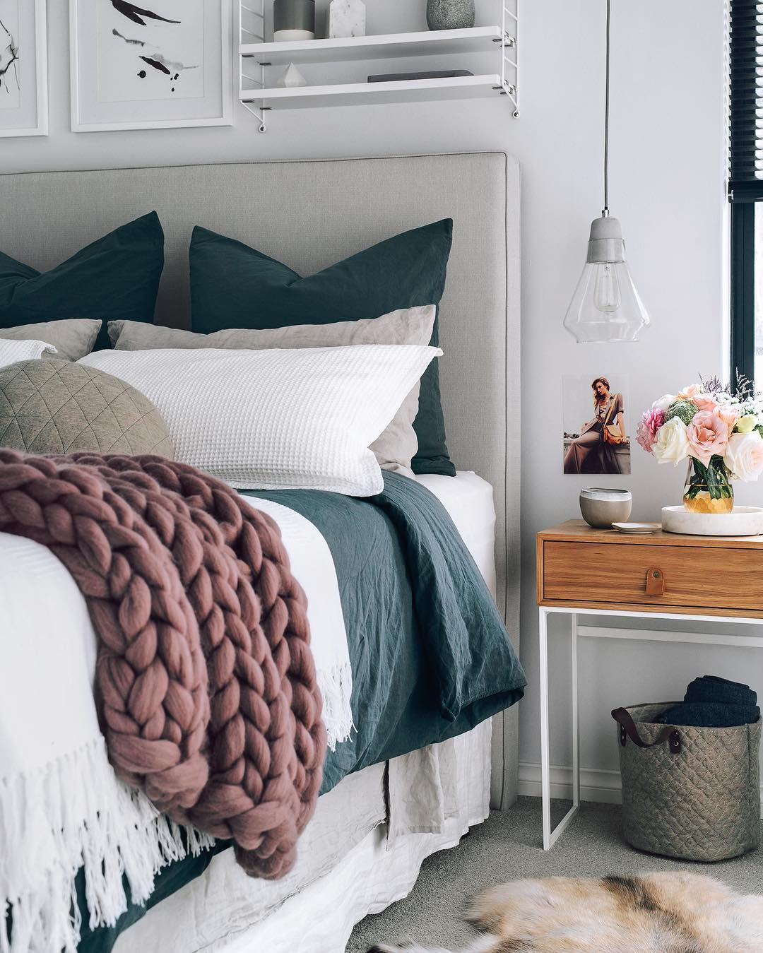 Hygge Interior Design Style and Life Philosophy: Cozy Danish Tradition. Thick woven clothes and delicate bed linen in cozy arranged bedroom