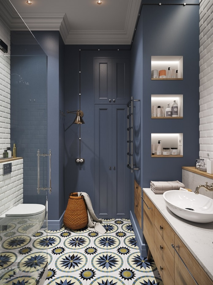 Hygge Interior Design Style and Life Philosophy: Cozy Danish Tradition. Blue wainscoted classic bathroom with shallow metro tile