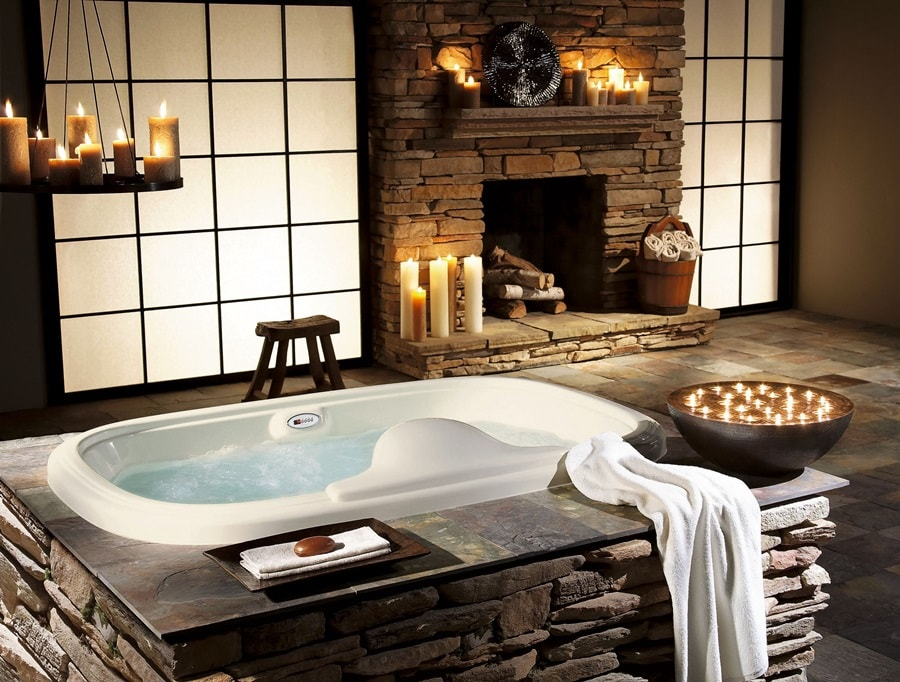 Hygge Interior Design Style and Life Philosophy: Cozy Danish Tradition. Chic bathroom interior with stone trimmed fireplace