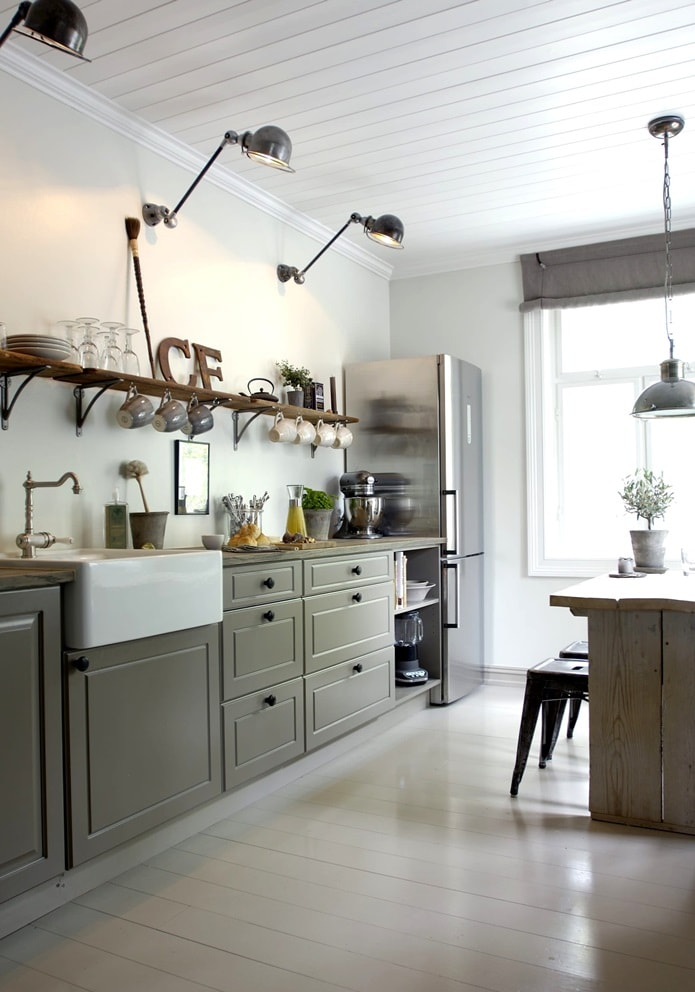 Hygge Interior Design Style and Life Philosophy: Cozy Danish Tradition. Simple kitchen design with gray facades of the furniture set