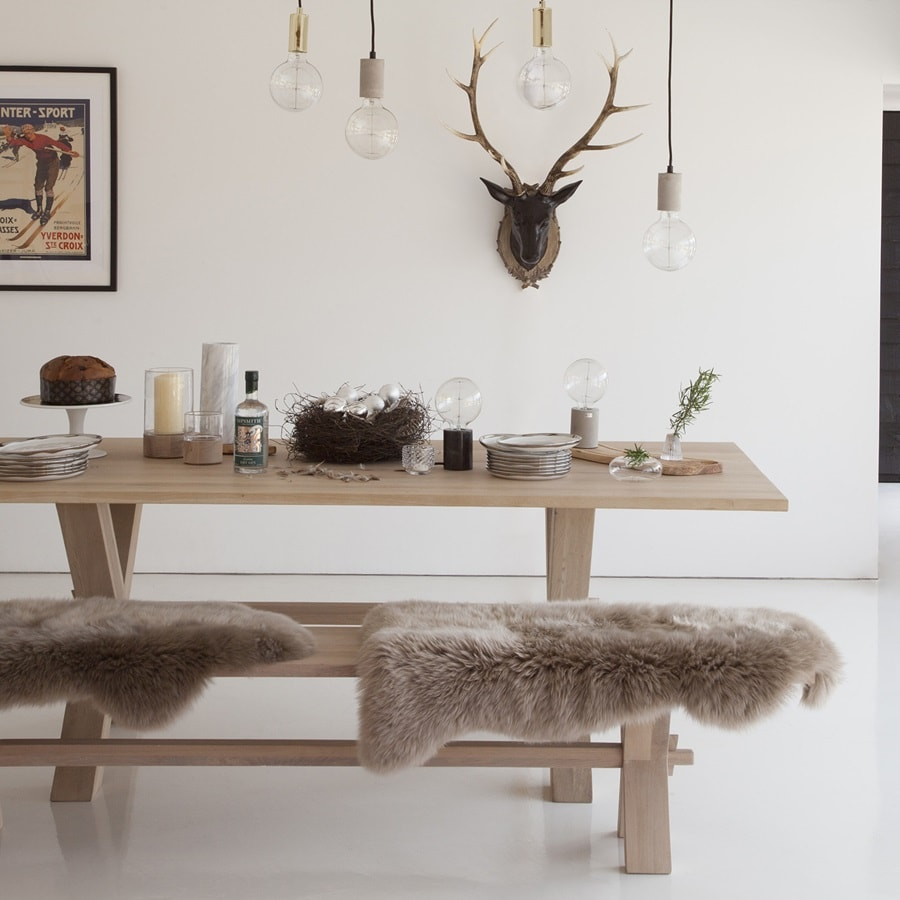 Strict Danish minhimalism with pelts on wooden furniture in the dining room