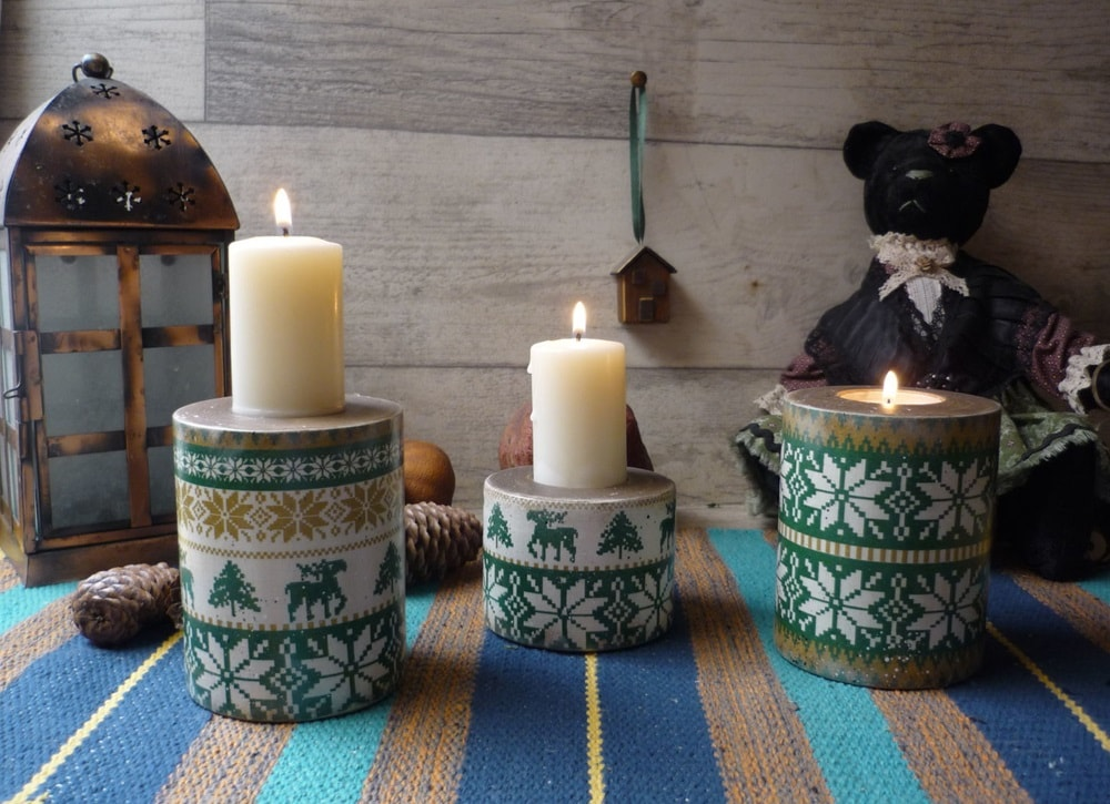 Candles at the round boxes with traditional Scnadinavian pattern