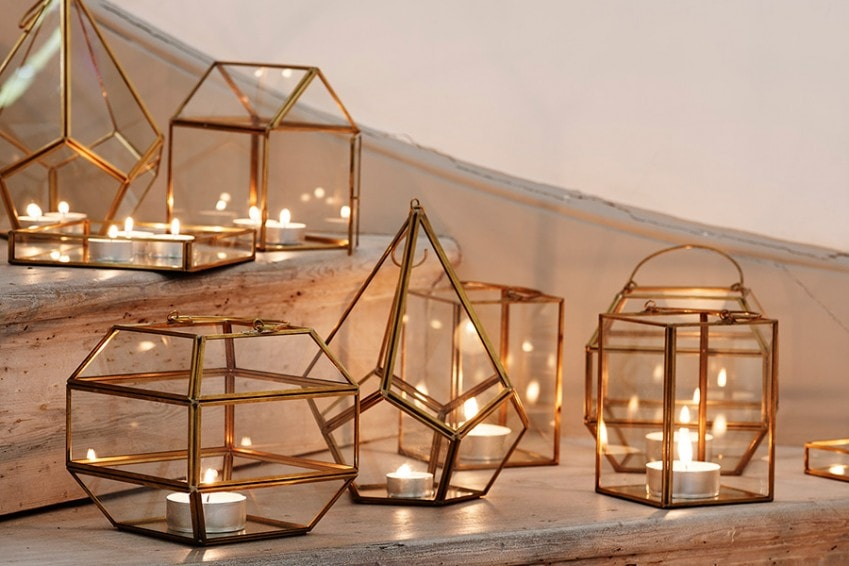 Unusual lamps for candles of gilded metal frame and glass