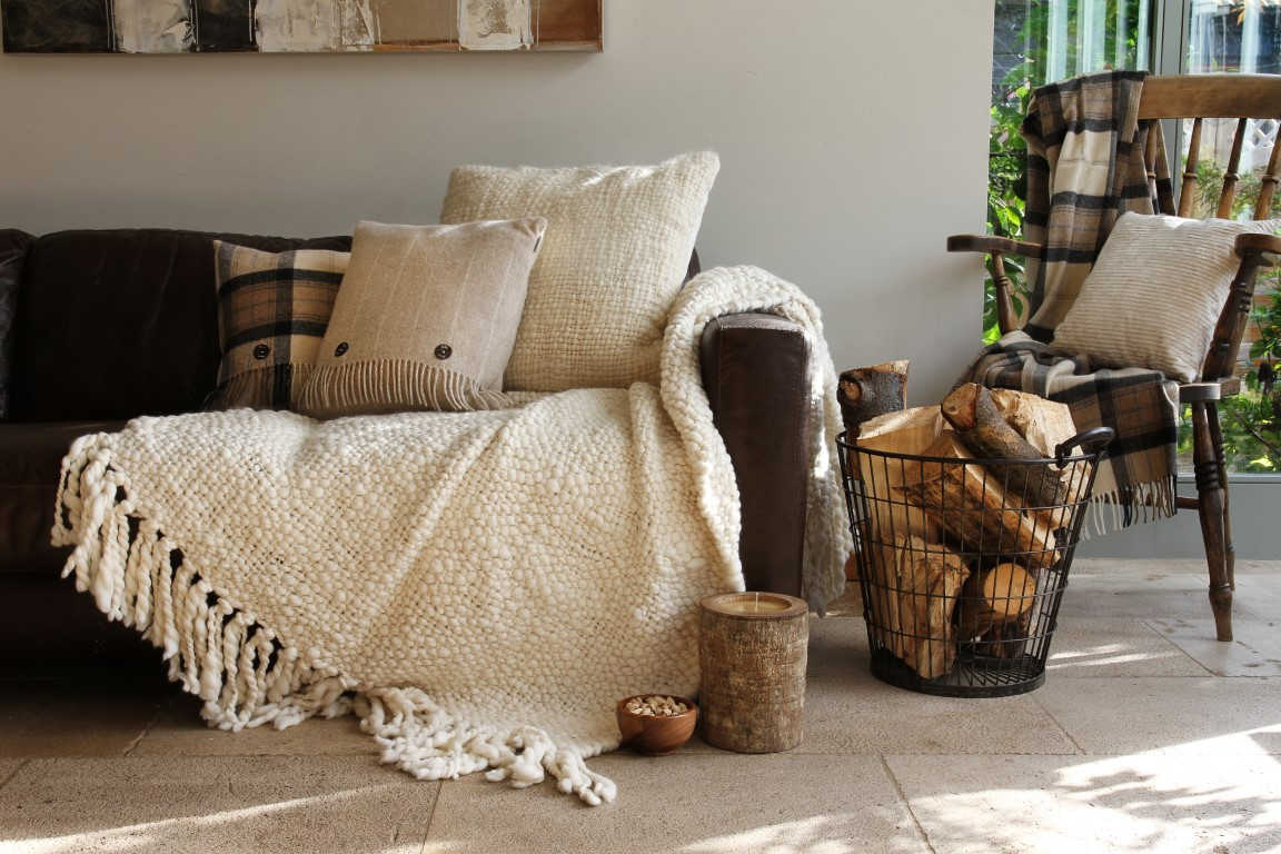 Rustic Scandinavian atmosphere with wood and fluffy blankets