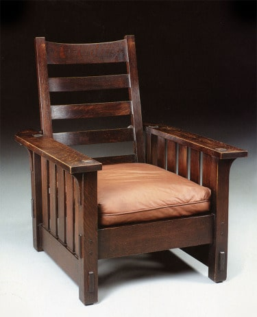 Arts and Crafts Interior Design: Origins and Perspectives of the Style. Crafted chair of dark wood with the pillow