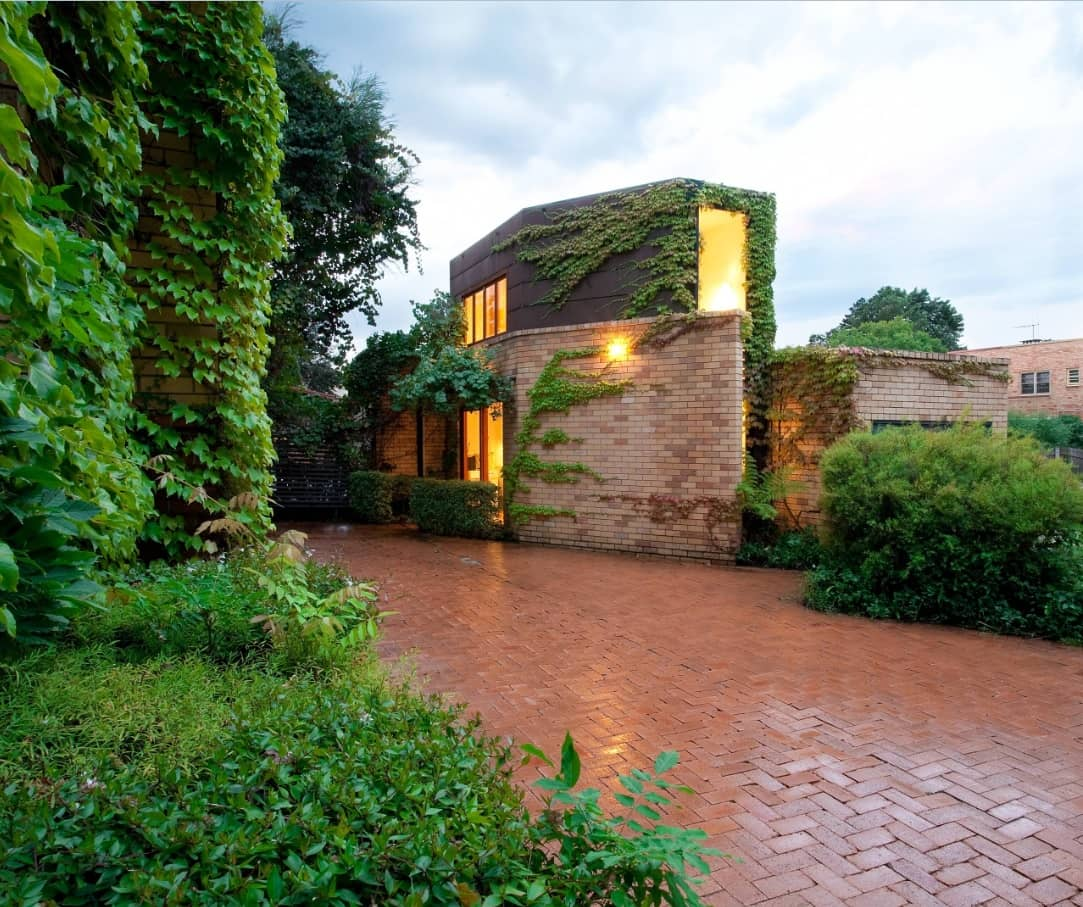 8 Benefits of Installing Brick Pavers. Greenery and pavement for suburb English style house