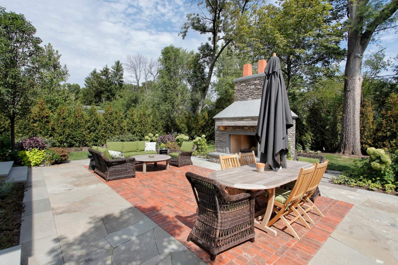 8 Benefits of Installing Brick Pavers. Ceramic paving of the barbecue zone with dark wicker furniture