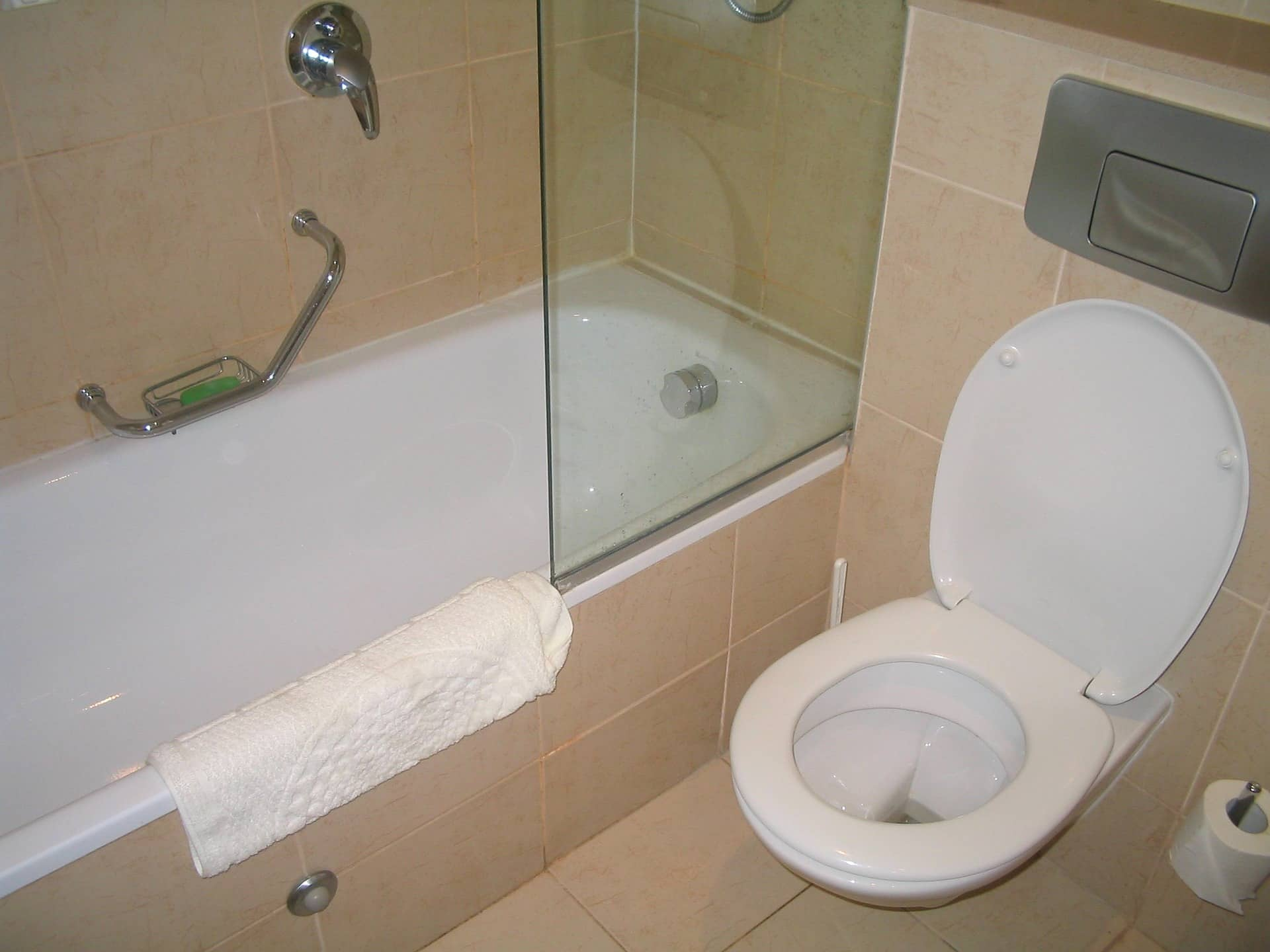 Why Compact Toilets Are Best for Small Bathrooms. Casual style for an area with bathtub shower zone and toilet
