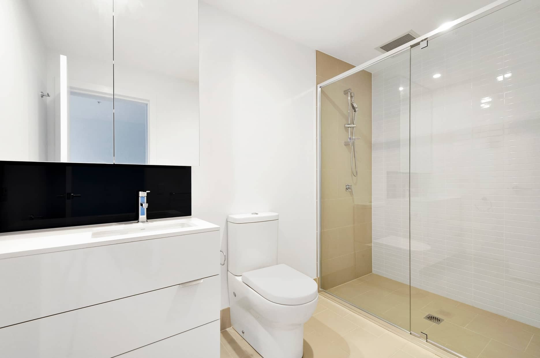 Why Compact Toilets Are Best for Small Bathrooms. Light modern styled room with glass zoned shower