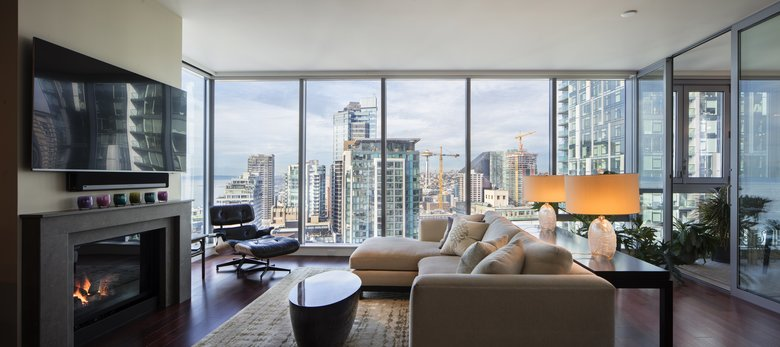 5 Reasons Why Choosing a Luxury Condo is the Best Way to Live in Downtown Seattle. great urban outside view from the panoramic windows of modern open layout apartment