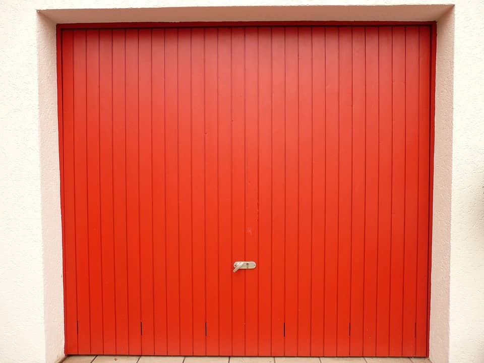 Common Reasons Why Garage Doors Won't Open that You Probably Don't Know About. Red planked classic door